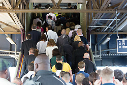 © Licensed to London News Pictures. 09/07/2015. London, UK. Passengers queue to get on a platform at Clapham Junction station in south London. A tube strike today has closed the TfL London Underground network and has been called by Trade Unions in protest over the new all-night tube trains, due to start in mid-September.. Photo credit : Vickie Flores/LNP