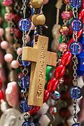 Rosary beads and cross at a Catholic shrine.
