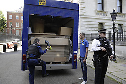 © Licensed to London News Pictures. 12/07/2016. London, UK. A removals van drives in the back of Downing Street. Mrs May will become Prime Minister tomorrow after the last candidate for leadership of the Conservative party stood down. Photo credit: Peter Macdiarmid/LNP