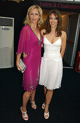 Left to right, TANIA BRYER and LIZ HURLEY at the 2006 Glamour Women of the Year Awards 2006 held in Berkeley Square Gardens, London W1 on 6th June 2006.<br />