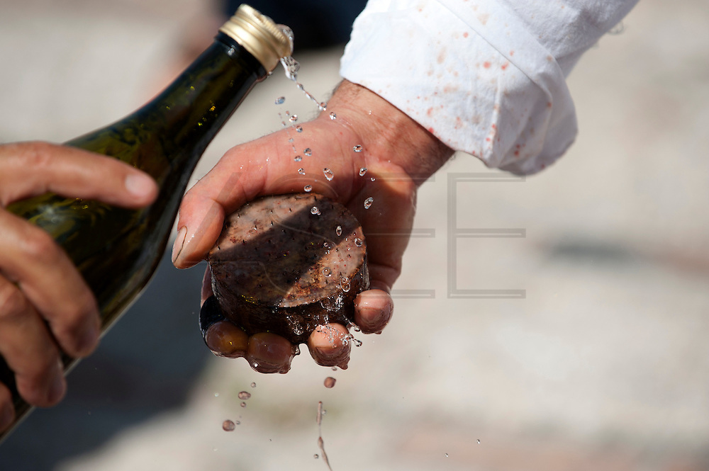"""The cork disk are disinfected with cheap white wine. Every seven years in August  in a small village named Guardia Sanframondi , a one-week long catholic procession, the """"Riti Settennali"""" takes place. <br /> From Monday to Friday the flagellant walk in the street of the medieval village striking their back with small strips of metal to honour the Assumption of the Virgin Mary. The last day, Sunday, the Virgin Mary from the main church is carried around the village and venerated by the """"Battenti"""". The """"Battenti"""" are men that decide to commemorate the Assumption of the Virgin Mary beating their own chest with a cylindrical peace of cork pierced with needles (between 25 and 45)."""