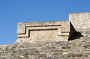 An architectural detail on Building H at Monte Alban set against a deep blue sky, Oaxaca, Mexico.