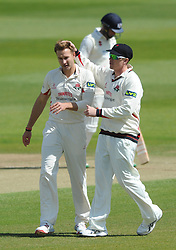 Kyle Jarvis of Lancashire celebrates with James Faulkner after bowling out Craig Miles of Gloucestershire for 12 in the second over  - Photo mandatory by-line: Dougie Allward/JMP - Mobile: 07966 386802 - 08/06/2015 - SPORT - Football - Bristol - County Ground - Gloucestershire Cricket v Lancashire Cricket Day 2 - LV= County Championship