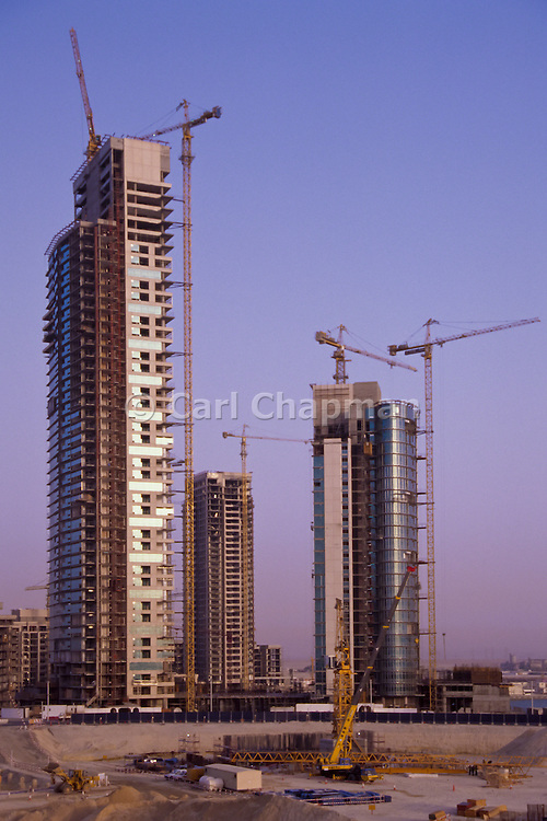 Highrise apartment building construction - Dubai, United Arab Emirates <br /> <br /> Editions:- Open Edition Print / Stock Image