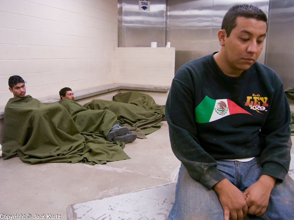 05 OCTOBER 2005 - DOUGLAS, AZ:  PABLO PEREZ FERREIRA sits in a Border Patrol holding cell in the BP station in Douglas, AZ. Ferreira said he was originally from Mexico City and was trying to get to Phoenix, AZ, where he had a job working as a house painter waiting for him. Apprehensions of illegal immigrants in the Douglas area are down significantly in the last 18 months. In 2003, the Border Patrol apprehended an average of 1,500 people a day in and around Douglas. In September and October 2005 they are apprehending only about 150 - 200 people a day.  PHOTO BY JACK KURTZ
