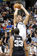 Dallas Mavericks power forward Dirk Nowitzki (41) shoots a jump shot over San Antonio Spurs center Boris Diaw (33) in the first half at American Airlines Center in Dallas, Texas, on January 25, 2013.  (Stan Olszewski/The Dallas Morning News)