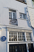 "An exterior of Clockwork Studios on Southwell Rd, in Brixton, south London, on 11th February 2021, in London, England. Clockwork Studios currently houses over 20 diverse independent art businesses but once accomodated comedians and clock makers. At the turn of the 20th century the ""Fun Factory"", as it was then known, was home to Fred Karno's Vaudeville theatre group. Silent movie stars Charlie Chaplin and Stan Laurel, two of Karno's most notable performers would have spent many hours there rehearsing. The Music Hall Guild of Great Britain and America recently fixed a commemorative blue plaque next to the main door to remember the comedy impresario Fred Karno. Also, while still young, future British Prime Minister, John Major lived a few streets away."