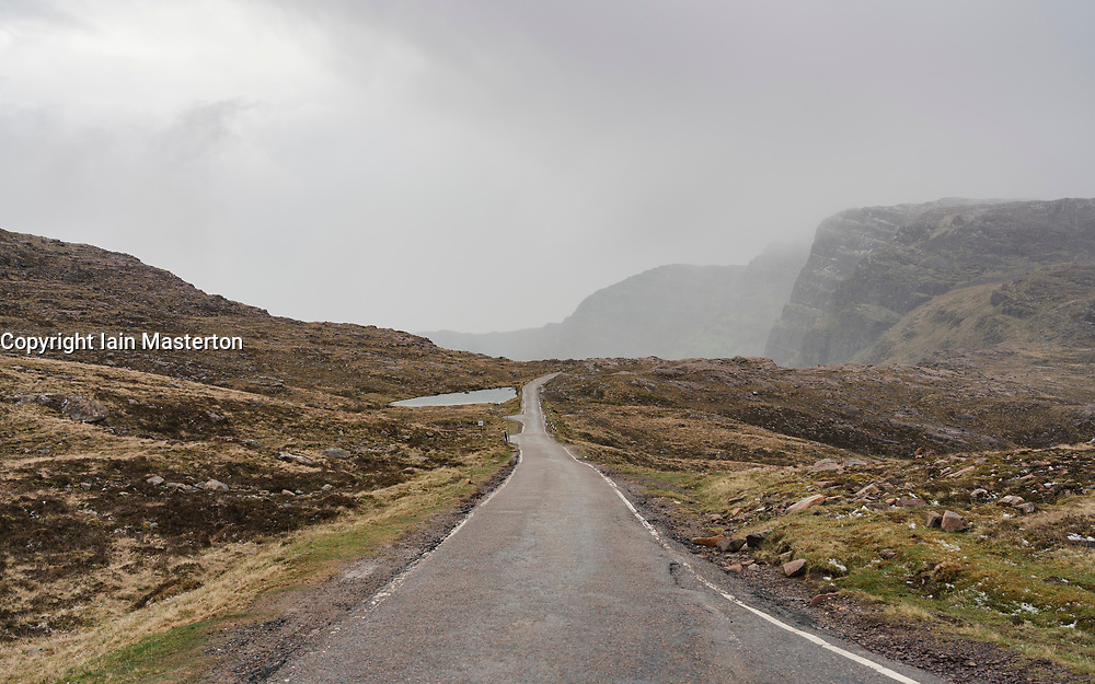 View of single track road and passing place on Bealach na Ba pass on Applecross Peninsula  the North Coast 500 driving route in northern Scotland, UK