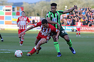 Lyle Taylor forward for AFC Wimbledon (33) and Matty Pearson defender Accrington Stanley (2) tussle during the Sky Bet League 2 play-off 2nd leg match between Accrington Stanley and AFC Wimbledon at the Fraser Eagle Stadium, Accrington, England on 18 May 2016. Photo by Stuart Butcher.