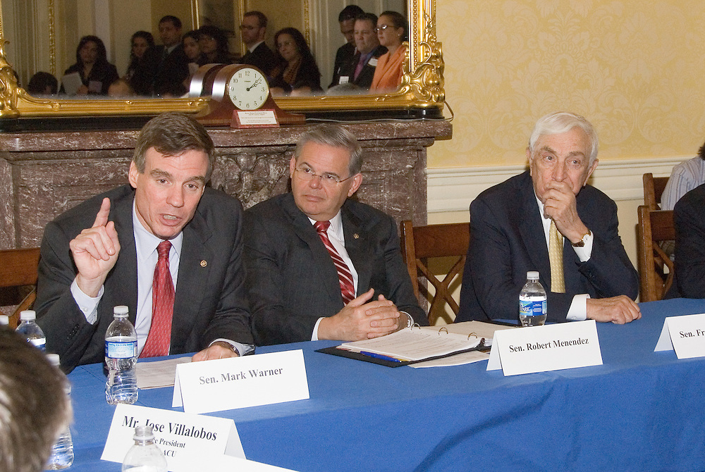 Senator Mark Warner (D-VA) speaks as Senators Robert Menendez (D-NJ) and Frank Lautenberg (D-NJ) look on during a meeting with Hispanic business leadersat the US Capitolin conjunction withtheUnited States Hispanic Chamber of Commerce's 19th Annual Legislative Conference, in Washington, DC, Wednesday, March 11, 2009.