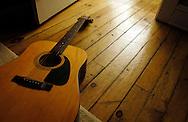 Guitar on wood floor