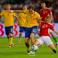 Sweden's Johan Elmander (front L) and Hungary's Vladimir Koman (front R) fight for the ball during the UEFA EURO 2012 Group E qualifier Hungary playing against Sweden in Budapest, Hungary on September 02, 2011. ATTILA VOLGYI