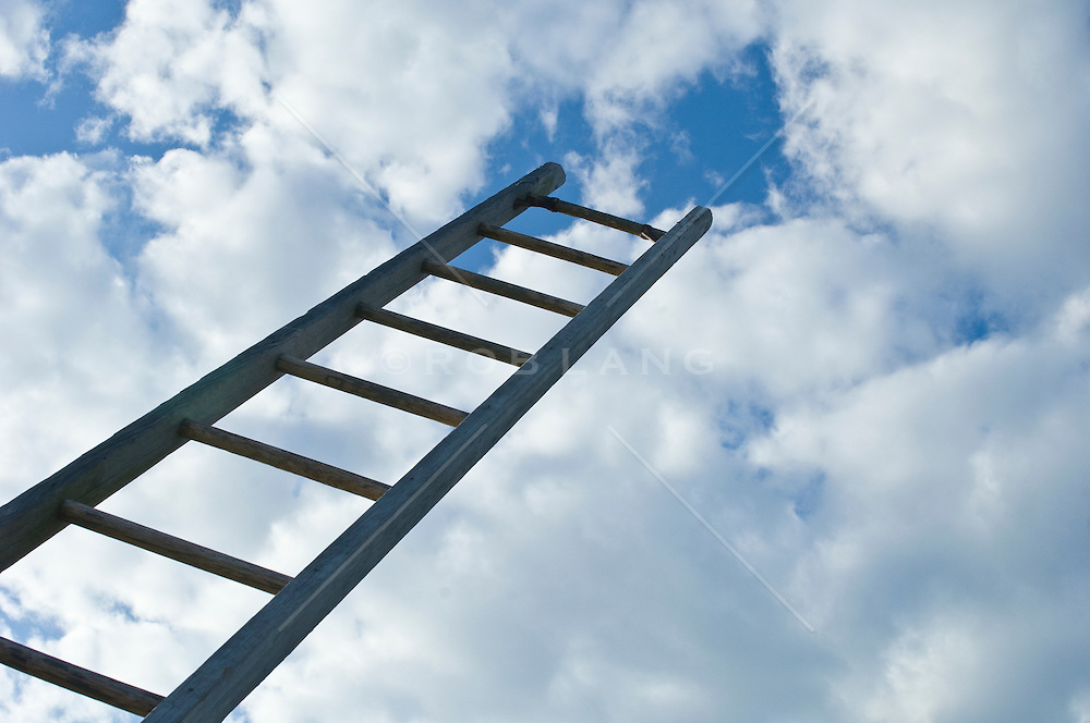 Ladder leading into clouds