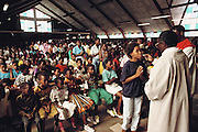 Regina Mundi Catholic Church Service. Soweto, South Africa (Southwest Township is called Soweto, and is located outside Johannesburg, South Africa). Material World Project.