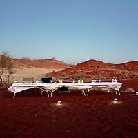 Africa, Namibia, Sossusvlei. Dinner in the dunes presented by Sossusvlei Desert Lodge.