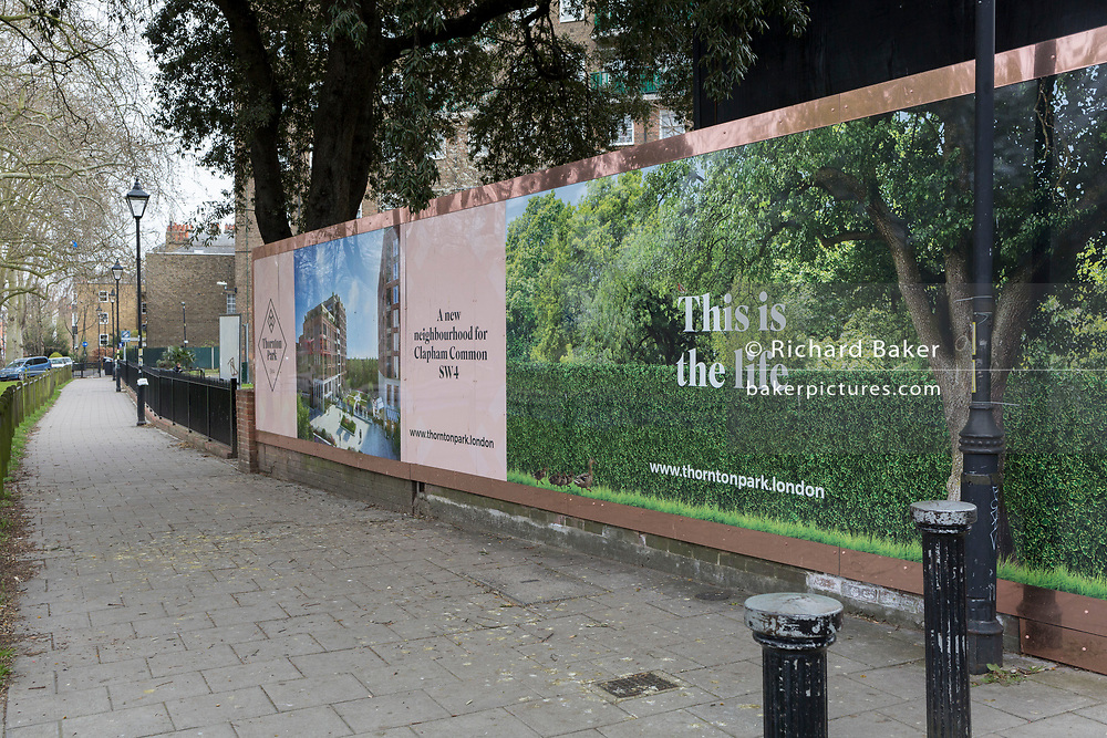 As the second week of the Coronavirus lockdown continues around the capital, and the UK death toll rising by 563 to 2,325, with 800,000 reported cases of Covid-19 worldwide, a billboard for nearby housing development, Thornton Park, spells out that this is the life, a utopian irony on an empty street during the pandemic lockdown, on 1st April 2020, in London, England.