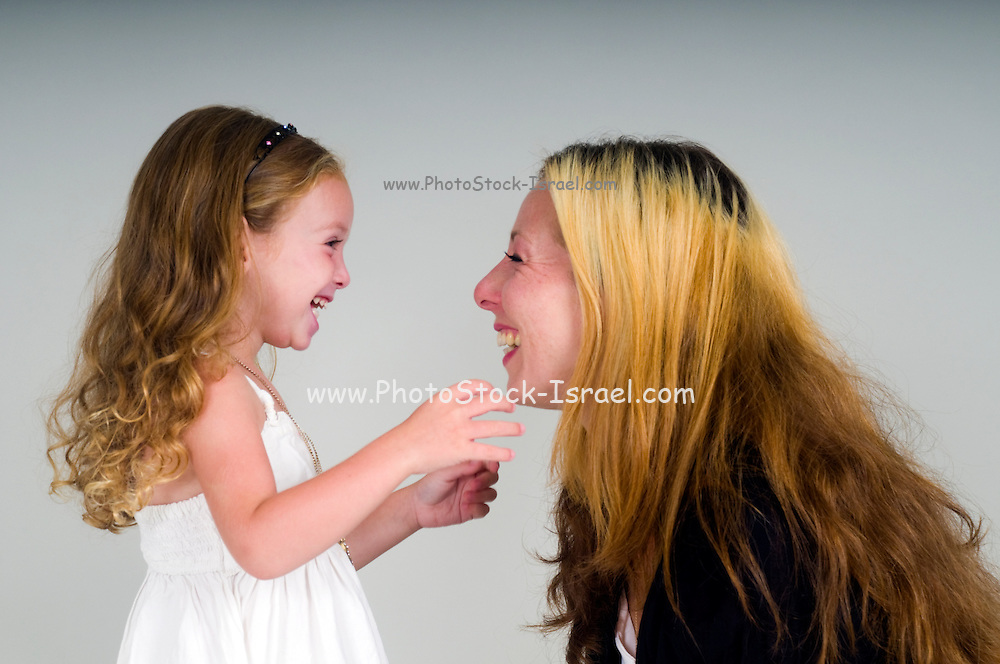 Mother and daughter of 3 playing