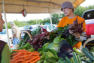 LIVING OFF THE GRID<br /> Jennifer Castellani at the Farmer's Market in Homer, Alaska.<br /> Anchor Point, Alaska, USA