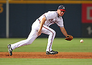 ATLANTA - JUNE 25:  Third baseman Chipper Jones #10 of the Atlanta Braves chases down a ground ball during the game against the New York Yankees at Turner Field on June 25, 2009 in Atlanta, Georgia.  The Yankees beat the Braves 11-7.  (Photo by Mike Zarrilli/Getty Images)