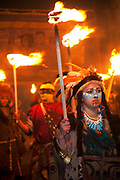 Lewes, UK. Monday 5th November 2012. Members carry burning torches dressed as American Indians on Bonfire Night celebration in the town of Lewes, East Sussex, UK which form the largest and most famous Guy Fawkes Night festivities. Held on 5 November, the event not only marks the date of the uncovering of the Gunpowder Treason and Plot in 1605, but also commemorates the memory of the 17 Protestant martyrs from the town burnt at the stake for their faith during the Marian Persecutions of 1555–57. There are six bonfire societies putting on parades involving some 3,000 people.