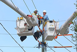 September 11, 2017 - St. Petersburg, Florida, U.S. - Linemen from Duke Energy work to restore power along 22nd Ave South and 38th Street South after the high winds of Hurricane Irma knocked out power.  (Credit Image: © Scott Keeler/Tampa Bay Times via ZUMA Wire)