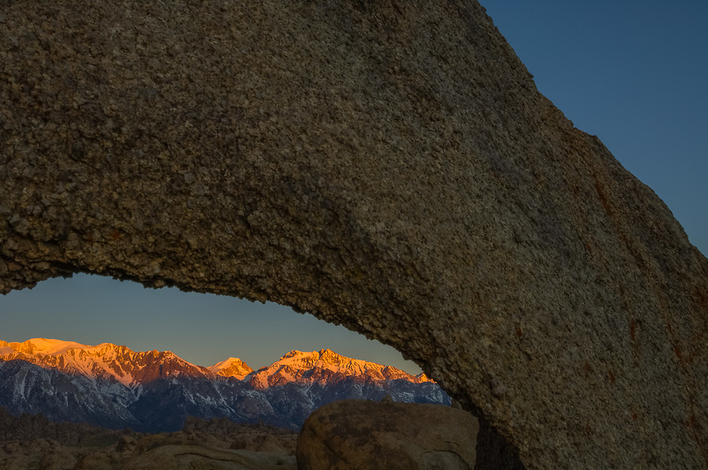 Eastern Sierra Mountains, morning light, April, framed by an eroded window in a granite boulder, Alabama Hills Recreation Area, U.S. Bureau of Land Management, Whitney Portal, Owens Valley, Inyo County, California, USA