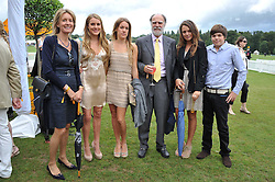 Left to right, VISCOUNTESS COWDRAY, the HON.EMILY PEARSON, the HON.ELIZA PEARSON, VISCOUNT COWDRAY, the HON.CATRINA PEARSON and the HON.MONTAGUE PEARSON at the 2011 Veuve Clicquot Gold Cup Final at Cowdray Park, Midhurst, West Sussex on 17th July 2011.