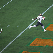 Bethune Cookman receiver Michael D. Jones (21) scores a touchdown in the third quarter during the Florida Classic NCAA football game between the FAMU Rattlers and the Bethune Cookman Wildcats at the Florida Citrus bowl on Saturday, November 22, 2014 in Orlando, Florida. (AP Photo/Alex Menendez)
