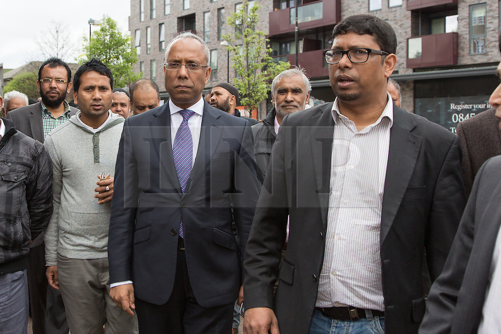 """© Licensed to London News Pictures. 05/04/2014. London, UK. Mayor of Tower Hamlets, Lutfur Rahman with his Deputy Mayor, Ohid Ahmed and supporters from the Tower Hamlets First party take part in a community walkabout in Stepney, East London on 5th April 2014 to canvas for the upcoming Mayoral election. Communities Secretary, Eric Pickles yesterday sent inspectors to start an audit of Tower Hamlets council and the Rahman administration following allegations of fraud and financial mismanagement, also reported by BBC's Panorama programme this week. Mayor Lutfur Rahman denies all allegations, which he calls """"Panorama lies"""". Photo credit : Vickie Flores/LNP"""