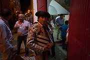 A Matadores pauses for a moment before entering the bullring at an evening Corrida de Touros, on 15th July 2016, at Caldas da Rainha, Portugal. A matador de toros or killer of bulls from Latin mactator, killer, slayer, from mactare, to slay is considered to be both an artist and an athlete, possessing great agility, grace, and co-ordination. The great personal danger of bullfighting adds to the performing matadors mystique; matadores are regularly injured by bulls and, concurrently, 533 professional bullfighters have been killed in the arena since 1700. In the Portuguese version, unlike Spanish bullfights, the bull is not killed.