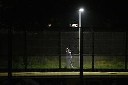 © Licensed to London News Pictures. 19/09/2021. London, UK. A forensic investigator gathers evidence in Cator Park on Kidbrooke Park Road in Greenwich following a call at 17:32BST on Saturday 18/09/2021 to the body of a female found near the community centre. A man was arrested several hours later at approximately 21:20BST at an address in Lewisham on suspicion of murder and was taken into custody at a south London police station. Photo credit: Peter Manning/LNP
