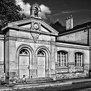A little boy looks for his mother outside the historic school, la Maison de Charite', in Croissy-sur-Seine, France. Film capture.   Aspect Ratio 1w x 1h.