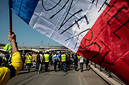 A demonstrator bringing the French flag.