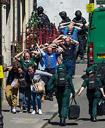 © Licensed to London News Pictures. 30/06/2015. London, UK. Members of the public being marched from the scene of the mocked-up shooting. Members of the emergency service take part in a mocked-up terrorist firearms attack at Aldwych station in central London. The exercise is the biggest to take place in London and is happening a week after dozens of people where killed when a gunman opened fire on a beach in Tunisia.  Photo credit: Ben Cawthra/LNP