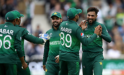 Pakistan's Mohammad Amir (right) celebrates the wicked of West Indies' Darren Bravo during the ICC Cricket World Cup group stage match at Trent Bridge, Nottingham.