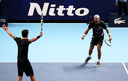 Lukasz Kubot and Marcelo Melo celebrate after the Doubles match during day six of the Nitto ATP Finals at The O2 Arena, London. PRESS ASSOCIATION Photo. Picture date: Friday November 16, 2018. See PA story TENNIS London. Photo credit should read: John Walton/PA Wire. RESTRICTIONS: Editorial use only, No commercial use without prior permission.