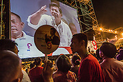 01 MARCH 2013 - BANGKOK, THAILAND: . Pheu Thai supporters listen to PONGSAPAT PONGCHAREON, the Pheu Thai candidate for governor of Bangkok, at the last election rally of the race. The election is Sunday, March 3 and no campaigning is allowed 24 hours before election day. Police General Pongsapat Pongcharoen (retired), a former deputy national police chief who also served as secretary-general of the Narcotics Control Board is the Pheu Thai Party candidate in the upcoming Bangkok governor's election. He resigned from the police force to run for Governor. Former Prime Minister Thaksin Shinawatra reportedly personally recruited Pongsapat. Most of Thailand's reputable polls have reported that Pongsapat is leading in the race and likely to defeat Sukhumbhand Paribatra, the Thai Democrats' candidate and incumbent. The loss of Bangkok would be a serious blow to the Democrats, whose national base has been the Bangkok area.    PHOTO BY JACK KURTZ