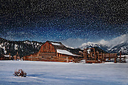 An artistic rendition of one of the historic barns along Mormon Row in Grand Teton National Park during a winter snow fall.