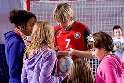 Maryna Vergeliuk with fans after the handball match of Round 3 of Champions League between RK Krim Mercator and Hypo Niederosterreich, on November 8, 2009, in Arena Kodeljevo, Ljubljana, Slovenia.  Krim won 35:24. (Photo by Vid Ponikvar / Sportida)