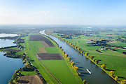 Nederland, Noord-Brabant, Gemeente Cuijk, 24-10-2013; Maas ter hoogte van Kraaijenbergse Plassen. Grensrivier tussen Gelderland en Brabant (Maaskant).<br /> River Meuse, border between Gelderland en Brabant.<br /> luchtfoto (toeslag op standaard tarieven);<br /> aerial photo (additional fee required);<br /> copyright foto/photo Siebe Swart.