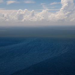 A oil sheen is seen in the Gulf of Mexico off the coast of Louisiana, U.S., on Monday, July 26, 2010. BP Plc is now preparing their 'static kill' option that involves pumping mud into the well to force oil back into the reservoir below. Photographer: Derick E. Hingle/Bloomberg