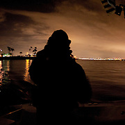 """Mark Allen White, Director of Marine Interdiction unit of  Customs and Border Protection, .San Diego Air & Marine Branch, patrols the waters near the US/Mexico border for undocumented immigrants in the early morning hours. The unit is also on patrol for gun smugglers hauling firearms into Mexico which is helping to fuel the Narco wars raging in Mexico. For more images, search for """"immigration by air and sea"""". Please contact Todd Bigelow directly with your licensing requests."""