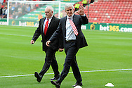 Stoke city manager Mark Hughes arrives for his 1st home competitive match in charge.  Barclays Premier league match, Stoke city v Crystal Palace at the Britannia Stadium in Stoke on Trent on Saturday 24th August 2013. pic by Andrew Orchard , Andrew Orchard sports photography,