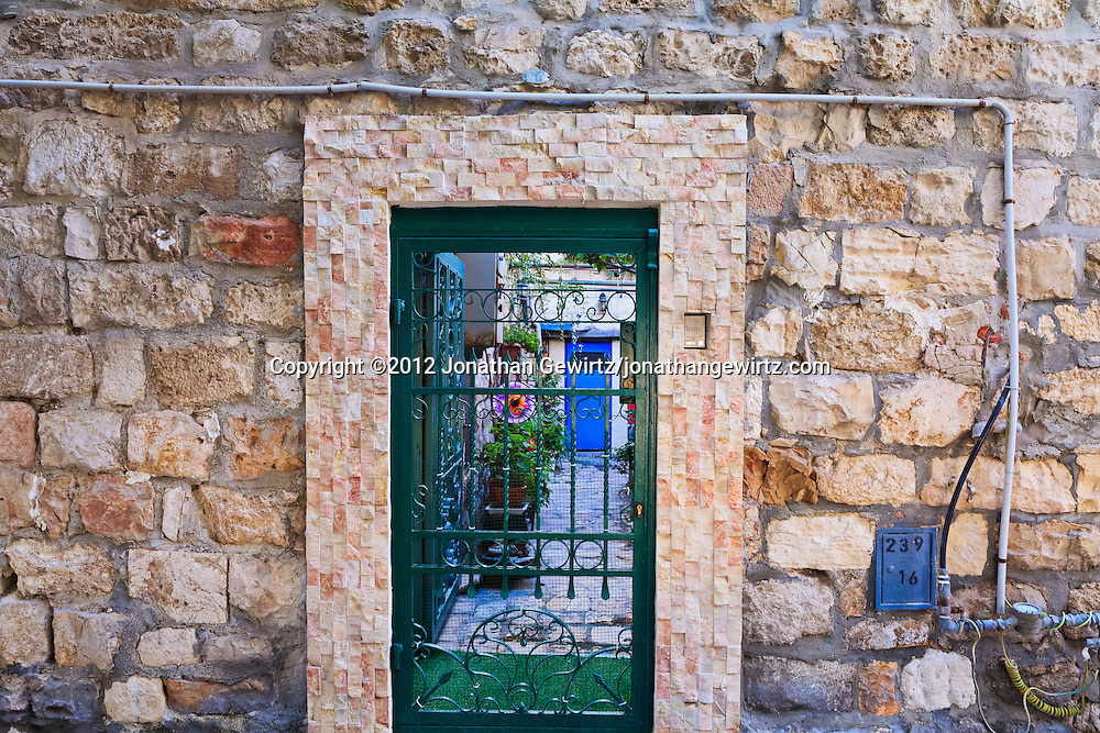 A wrought iron gate protects the entrace to a residential courtyard on Habad Street in the Old City of Jerusalem. WATERMARKS WILL NOT APPEAR ON PRINTS OR LICENSED IMAGES.