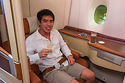 Lobster, a full-size bed and a private departure room: Young entrepreneur blows $30,000 of air miles on world's most luxurious flight from Singapore to New York... and blogs every last detail<br /> <br /> With endless lobster meals, a full-size bed and designer toiletries, it could be a five-star hotel.<br /> But this is actually a private suite on a Singapore Airlines Airbus A380 - worth a staggering $23,000.<br /> Young entrepreneur Derek Low cashed in 93,500 frequent flier miles to travel in the airlines's Suites Class - voted the most luxurious cabin in the world - from Singapore to New York. <br /> <br /> <br /> He snapped photos of his experience - from an exclusive departure lounge called 'The Private Room' to hand-stitched leather armchairs -  before posting them online.<br /> His Medium.com blog, titled 'What it's like to fly the $23,000 Singapore Airlines Suites Class', documents his incredible flight experience, from check-in to landing. <br /> <br /> Upon entering Singapore Changhi Airport, Mr Low's VIP treatment started immediately.<br /> He took his luggage to a check-in lounge for First Class and Suites passengers, which he described as 'like a hotel lobby and even had a bellhop who carries your luggage.'<br /> <br /> Once there, he was startled to find that his suitcases were not weighed, before they were checked in and he was handed a 'Golden Ticket', along with an invitation to 'The Private Room'.<br /> The exclusive lounge, which staff reportedly claim is 'higher than First Class', was located past the busier and less luxurious Business and First Class lounges. <br /> Mr Low said: 'Entering the confines of The Private Room, the staff greeted me by name. It's like they all already knew me before even meeting me.'<br /> Once settled in the lounge, the entrepreneur ordered a glass of champagne, a mango smoothie and three dishes: Chicken and Mutton Satay pate, Baked Boston Lobster with Gruyere, Emmenthal and Cheddar, and the U.S. Prime Beef Burger with Foie Gras, Rocket Leaf and Fried Quail Egg. <br /> <br /> He then walked across a 'jet bridge solely f