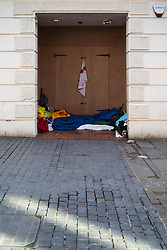"""A rough sleeper's 'bedroom' in the doorway of a closed shop. After a public outcry against their """"homelessness support strategy"""" where rough sleepers would have been fined £100, Windsor council has shelved their plans. Windsor, Berkshire, February 16 2018."""