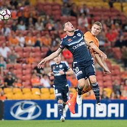 BRISBANE, AUSTRALIA - OCTOBER 7: Thomas Kristensen of the Roar and James Troisi of the Victory compete for the ball during the round 1 Hyundai A-League match between the Brisbane Roar and Melbourne Victory at Suncorp Stadium on October 7, 2016 in Brisbane, Australia. (Photo by Patrick Kearney/Brisbane Roar)