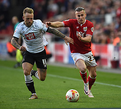 Joe Bryan of Bristol City fends off Johnny Russell of Derby County - Mandatory by-line: Paul Knight/JMP - 19/04/2016 - FOOTBALL - Ashton Gate Stadium - Bristol, England - Bristol City v Derby County - Sky Bet Championship