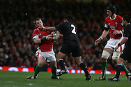 Matthew Rees of Wales is tackled by New Zealand's Keven Mealamu (2). Invesco Perpetual series 2008 autumn international match, Wales v New Zealand at the Millennium Stadium on Sat 22nd Nov 2008. pic by Andrew Orchard, Andrew Orchard sports photography,