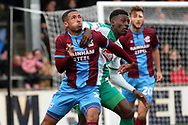 Scunthorpe United defender Jordan Clarke (2) and Plymouth Argyll forward Freddie Ladapo (19) battle for possession during the EFL Sky Bet League 1 match between Scunthorpe United and Plymouth Argyle at Glanford Park, Scunthorpe, England on 27 October 2018. Pic Mick Atkins